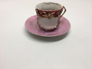 Antique Demitasse Cup & Saucer - Germany - Gilt Relief Pink Lusterware