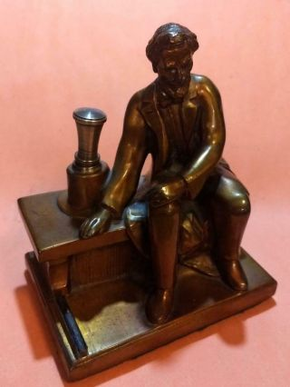 Gold Highlighted Copper Abe Lincoln Striker Table Lighter By Ronson - Amw - 1935