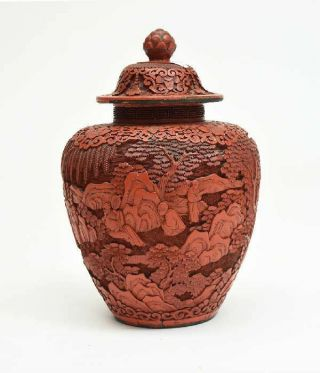 A Large And Rare Chinese Qing Dynasty Cinnabar Covered Vase With Wooden Stand.
